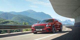 1-continental-gt-v8-driving-by-mountains