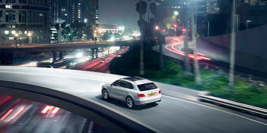 04 bentayga hybrid in white driving on a
