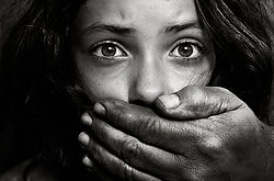 sex_trafficking_girl_with_hand_over_mouth.jpg