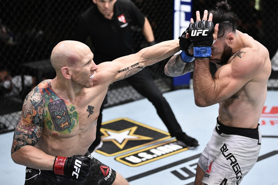 Josh Emmett punches Shane Burgos in their featherweight bout during UFC Fight Night at the UFC Apex. Photo: Chris Unger/Zuffa LLC via USA TODAY Sports