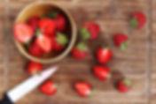 fresh-strawberries-being-cut.jpg