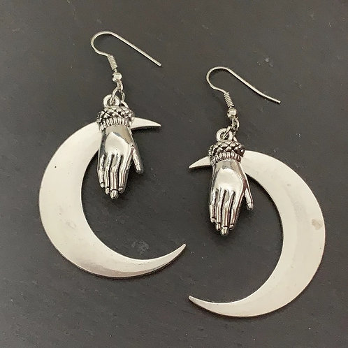 Silver crescent moon and hand earrings