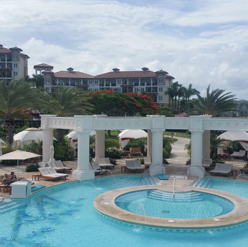 The huge main pool and swim up bar.