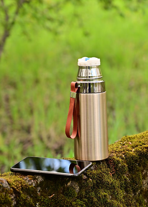 Photo%2520of%2520a%2520thermos%2520and%2520smartphone%2520in%2520the%2520forest%2520in%2520the%2520s