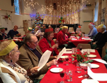 Photograph of a Christmas Lunch inside the Village Hall