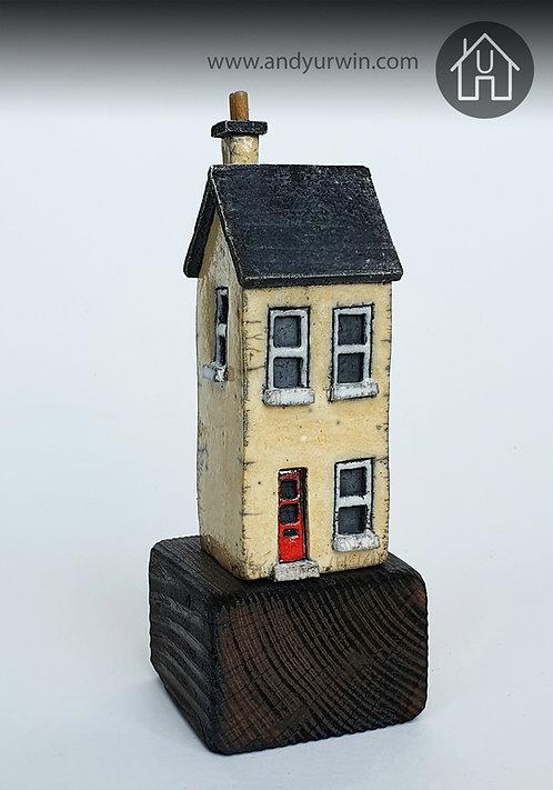 Raku house on wooden base
