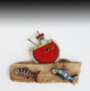 red boat.fish.driftwood