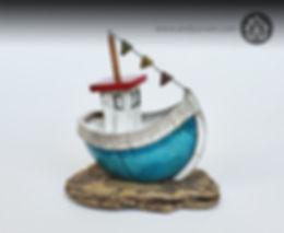 Handmade ceramic Raku turquoise boat with wooden mast, ceramic flags, sitting on a driftwood base