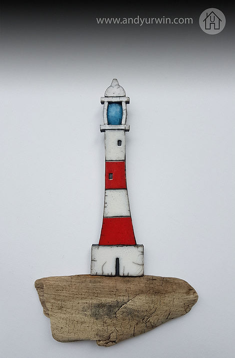 Red lighthouse on driftwood