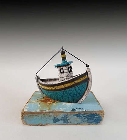 small turquoise boat driftwood