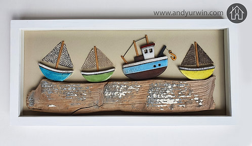 Framed Raku sail boats and trawler on a driftwood base
