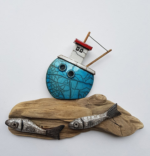Turquoise boat with fish