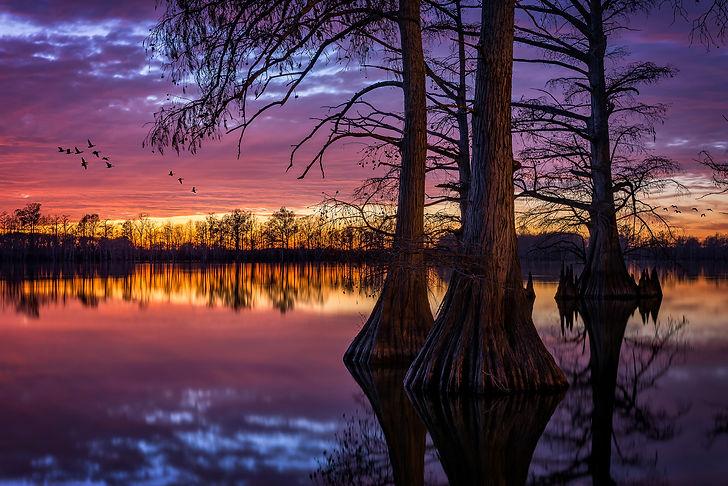 A dramatic sunset over Horseshoe Lake in