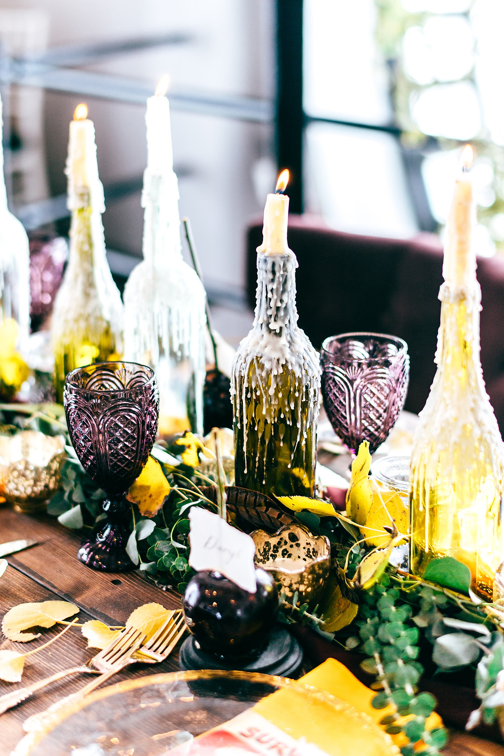Dark & Moody Post-Apocalyptic Wedding Tablescape with Maroons, Plums, and Gold
