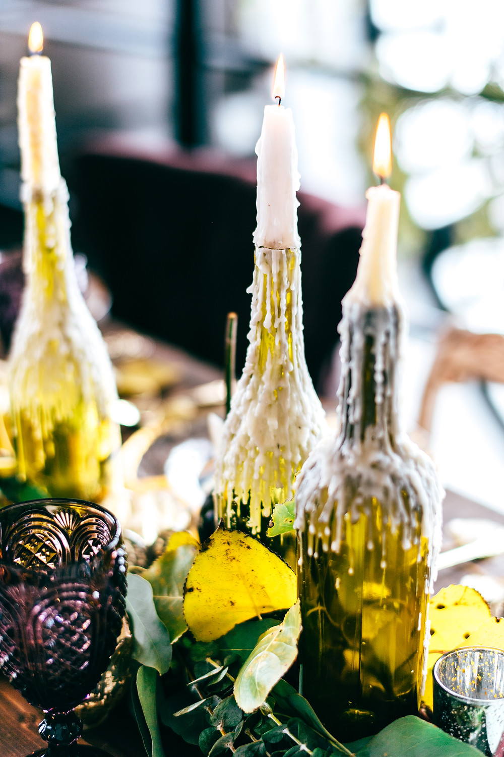 Dark & Moody Post-Apocalyptic Wedding Tablescape with Wax Dripped Wine Bottle Candle Holders