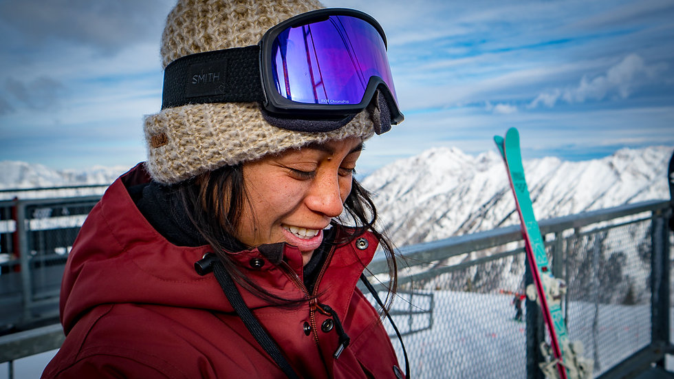 female skier on top of snowy mountain