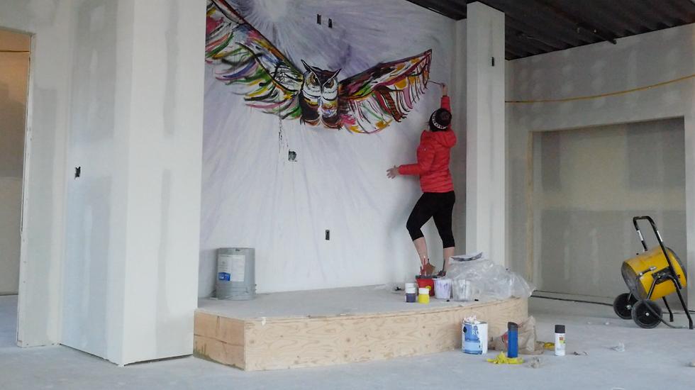 woman painting mural