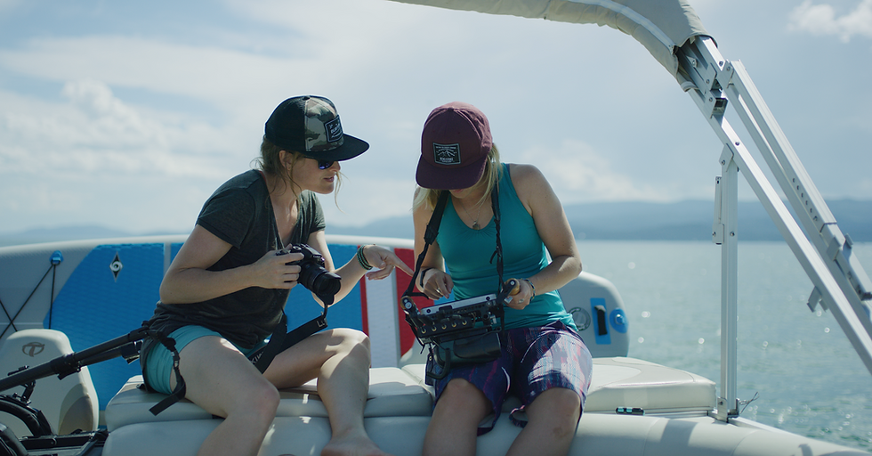 two women on boat with cameras