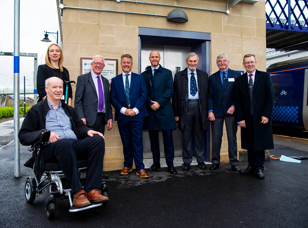 A group of local representatives in front of the new lift at Stirling Rail Station