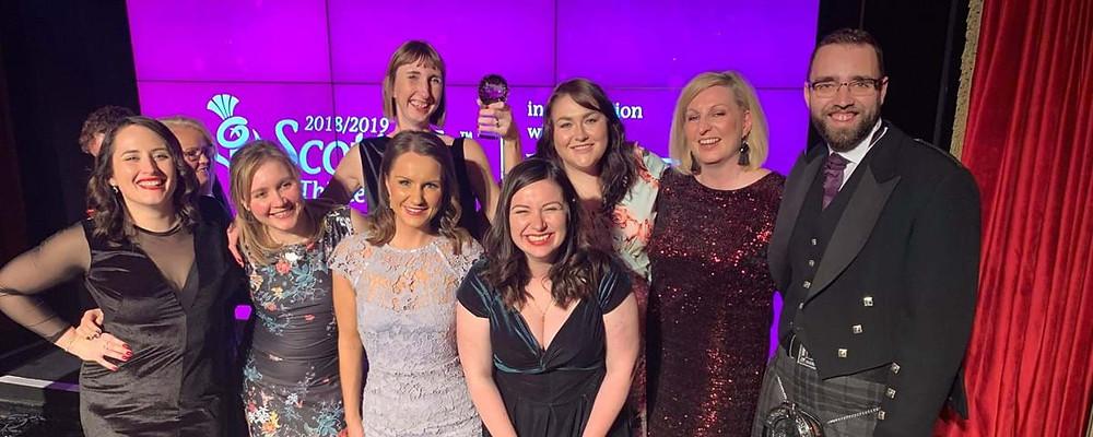 Historic Environment Scotland picking up their award at the Scottish Thistle Awards