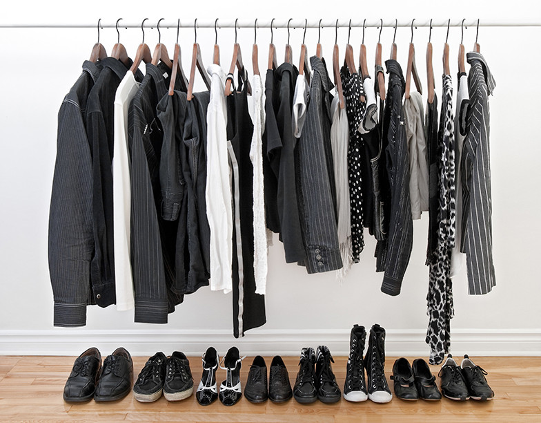Black and white clothes on hangers