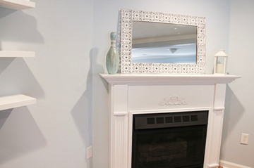 The fireplace featuring some cool thirft store finds!