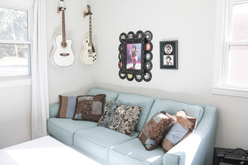 The music room!   Blue couch from Ashley Furniture!  Featuring a photo of me rocking out onstage by Matt Duboff!