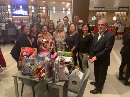 Latino Chamber Committee Toy Donation with Samaritan House Laura Bent, COO