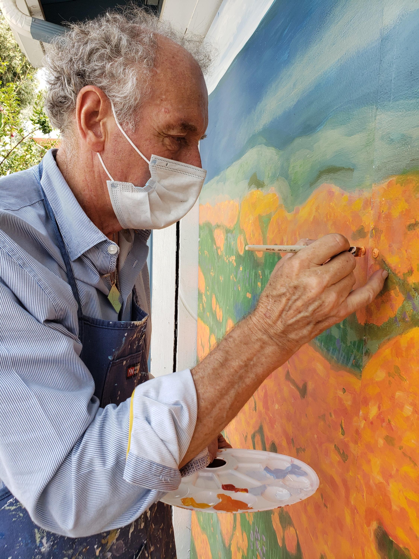Paul Maxwell Godfrey Artist/Muralist working on a handpainted Mural