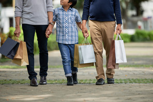 Anonymous boy holding hands of father an