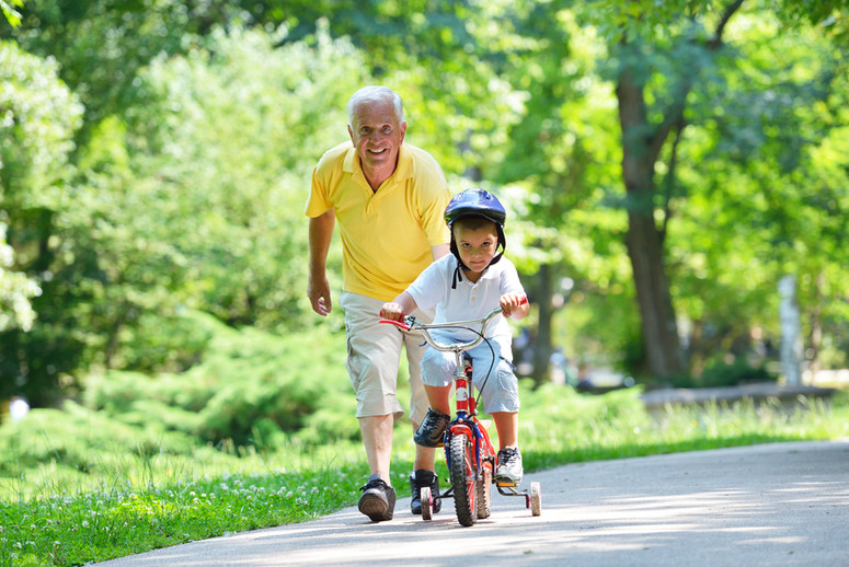 happy grandfather and child have fun and