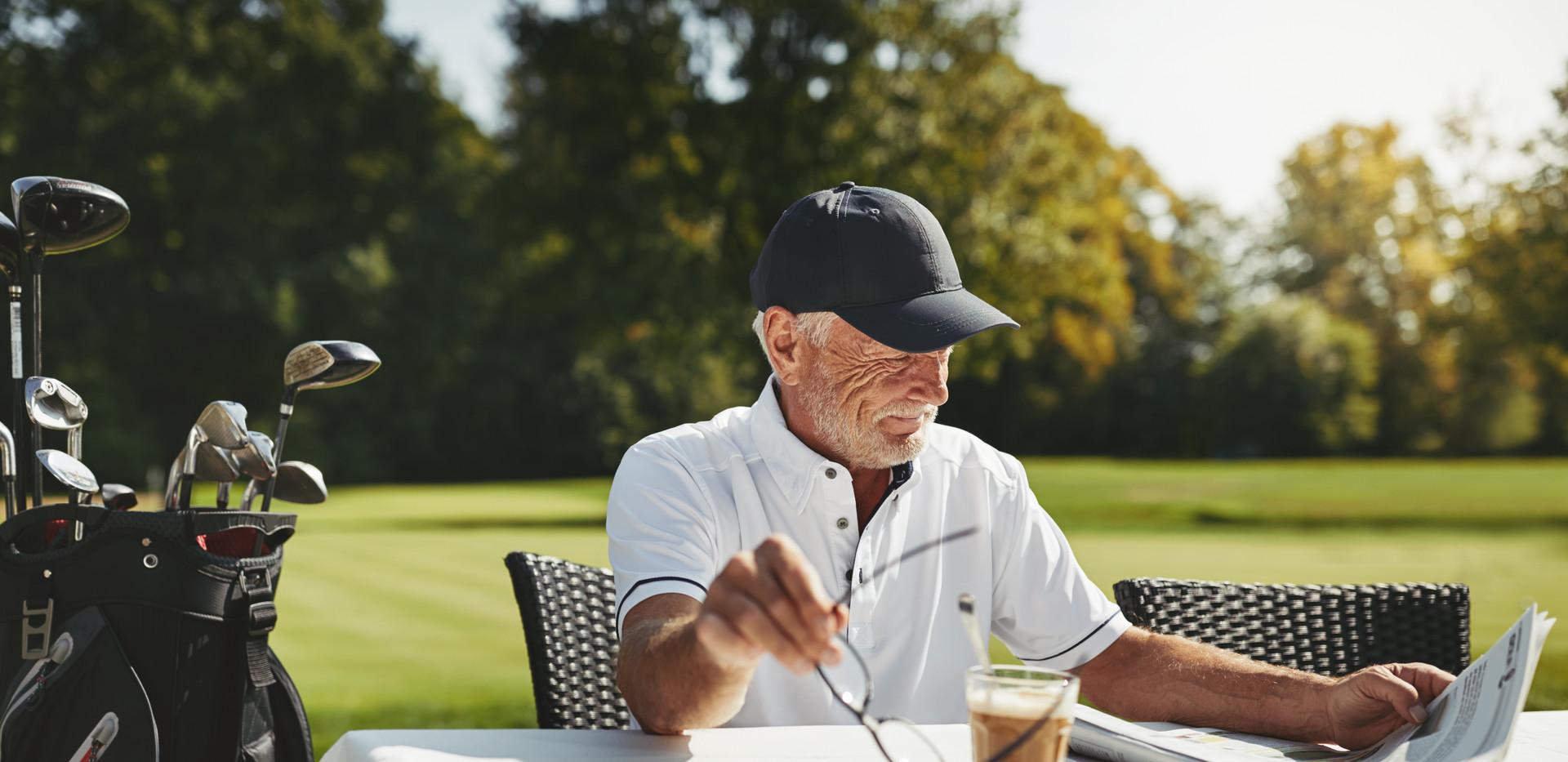 Smiling senior man relaxing at his golf