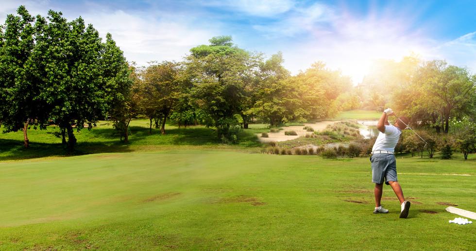 Panorama of Golfer hit sweeping golf bal