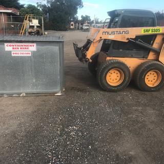 Bobcat lifting containment bin.jpg
