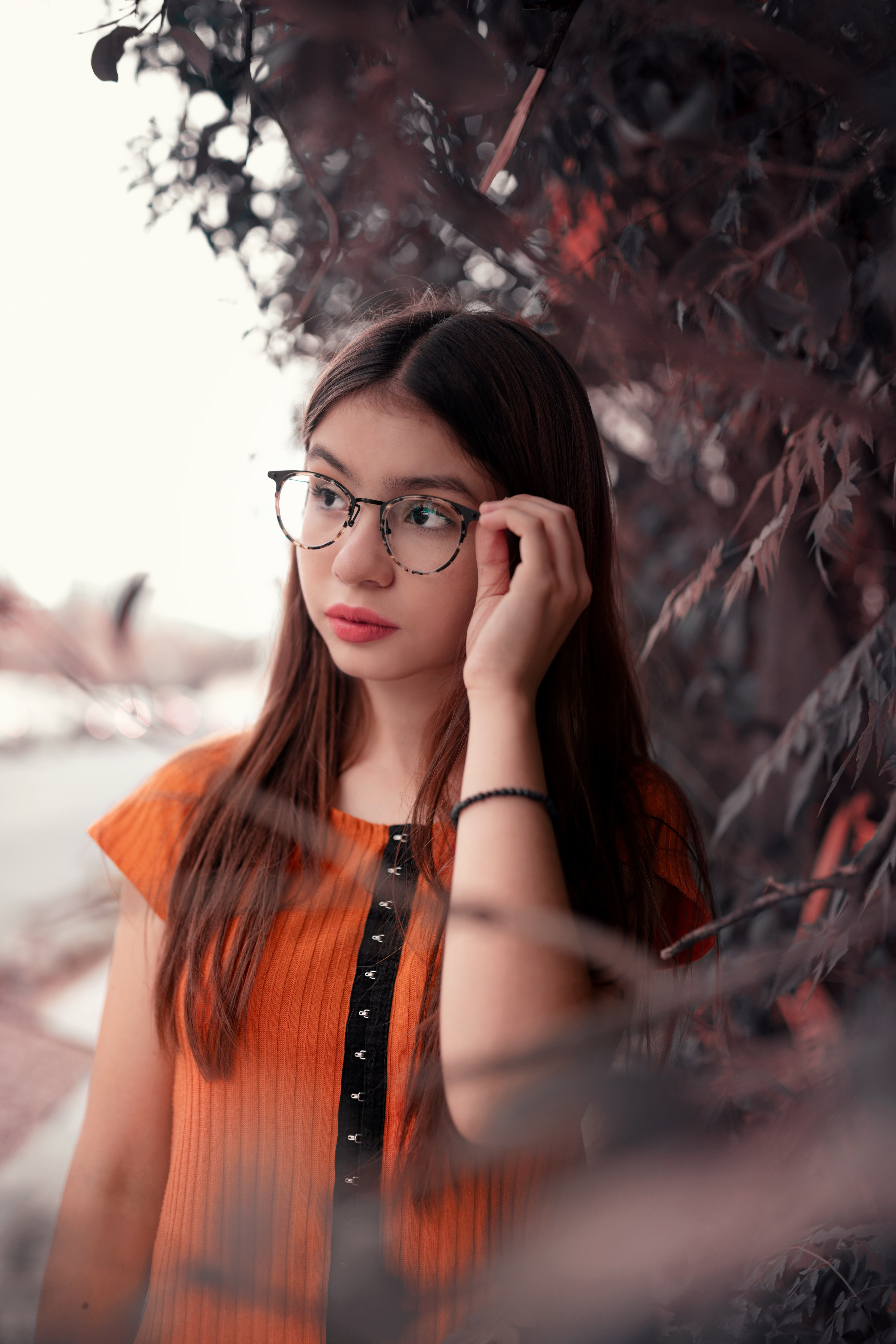 Teen girl with glasses and orange top