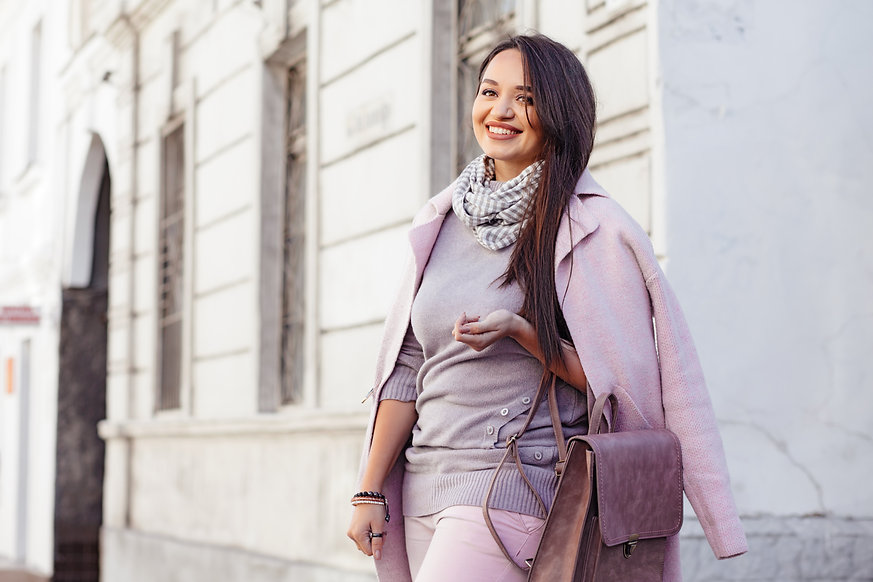 Young stylish woman wearing pink warm co