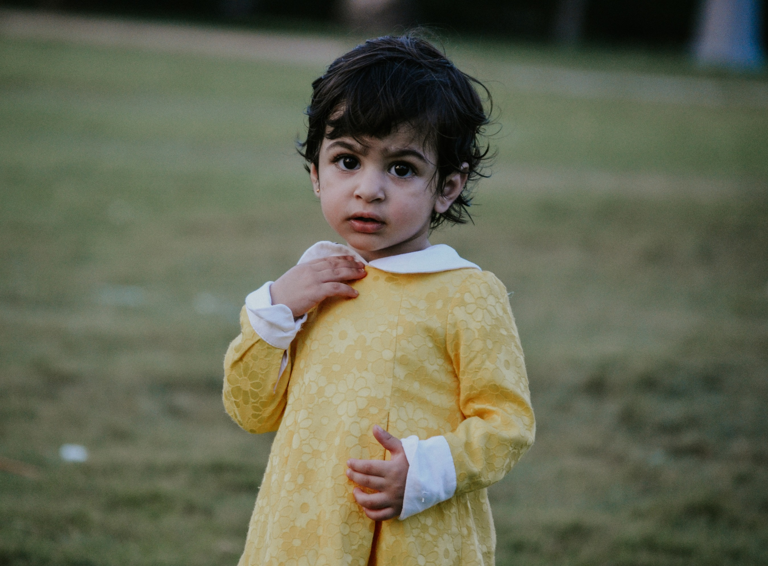 Child in yellow dress
