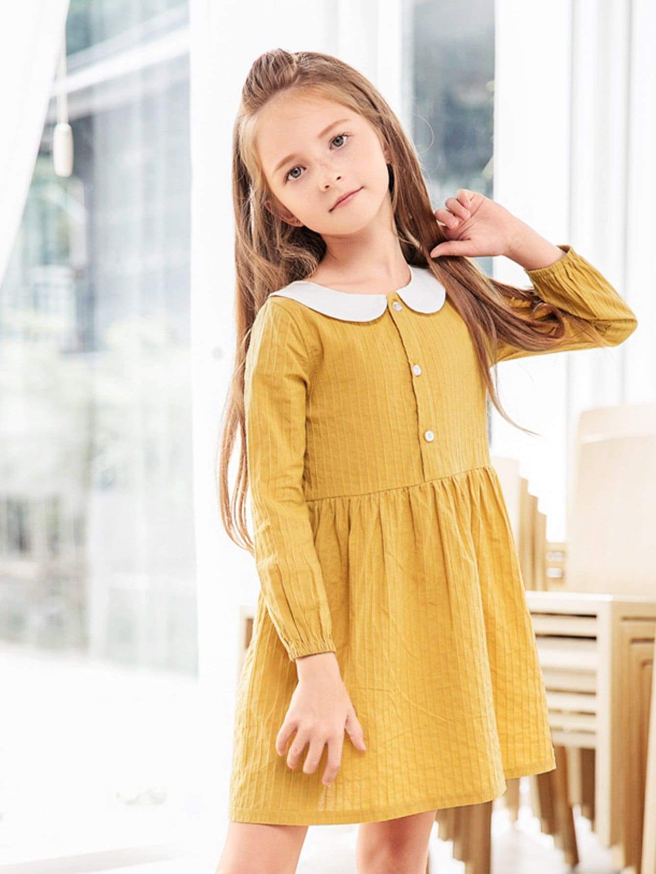 Girl on yellow dress