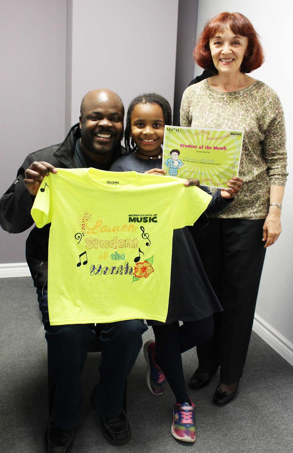 Lauren with Dad and piano teacher Ms. Raissa at Milton School of Music