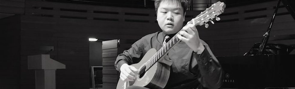 Mississauga School of Music student Zining W playing the classical guitar - winner of the highest classical guitar RCM exam score in Ontario in 2010