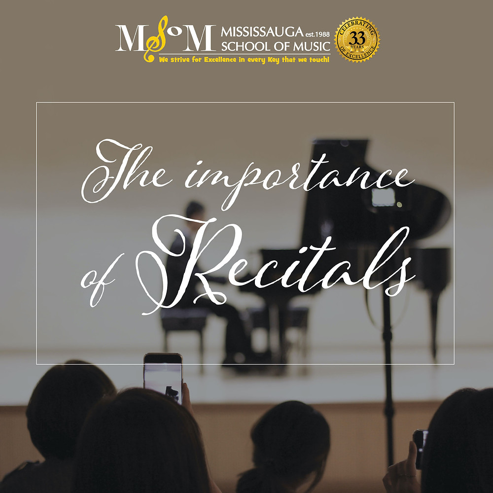 Audience point of view of a man sitting at grand piano at a piano recital.The importance of recitals.