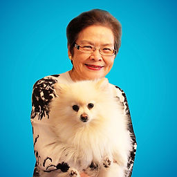 Mississauga School of Music Founder Jenny Goh holding a white pomeranian called Chanel
