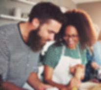 young-interracial-couple-making-pasta.pn