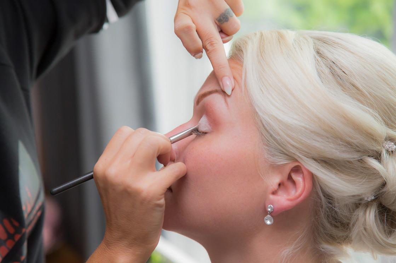 Bride getting makeup