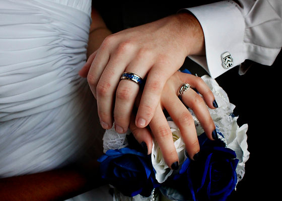man and woman weddng rings