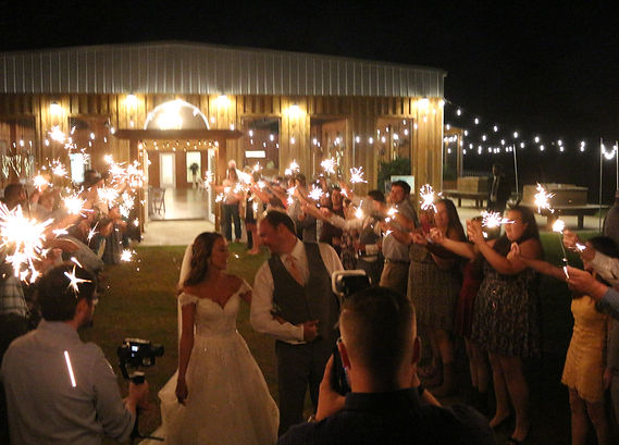 bride an groom sparklers