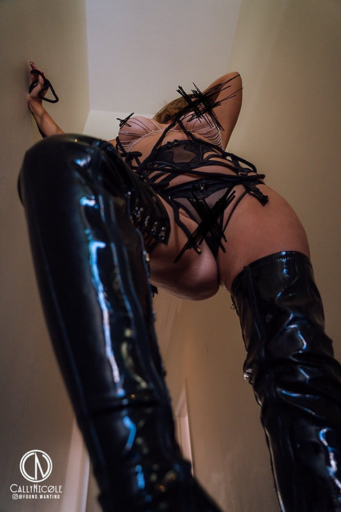 mistress elle lush dominatrix boots.jpg