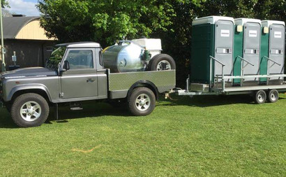 LANDROVER HITCHED UP WITH TOILETS.jpg
