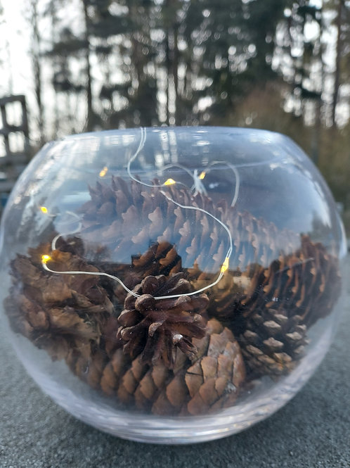 Glass bowl with mix of pine cones and lights