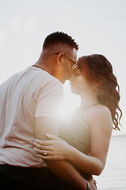 man-wearing-white-shirt-kissing-woman-in